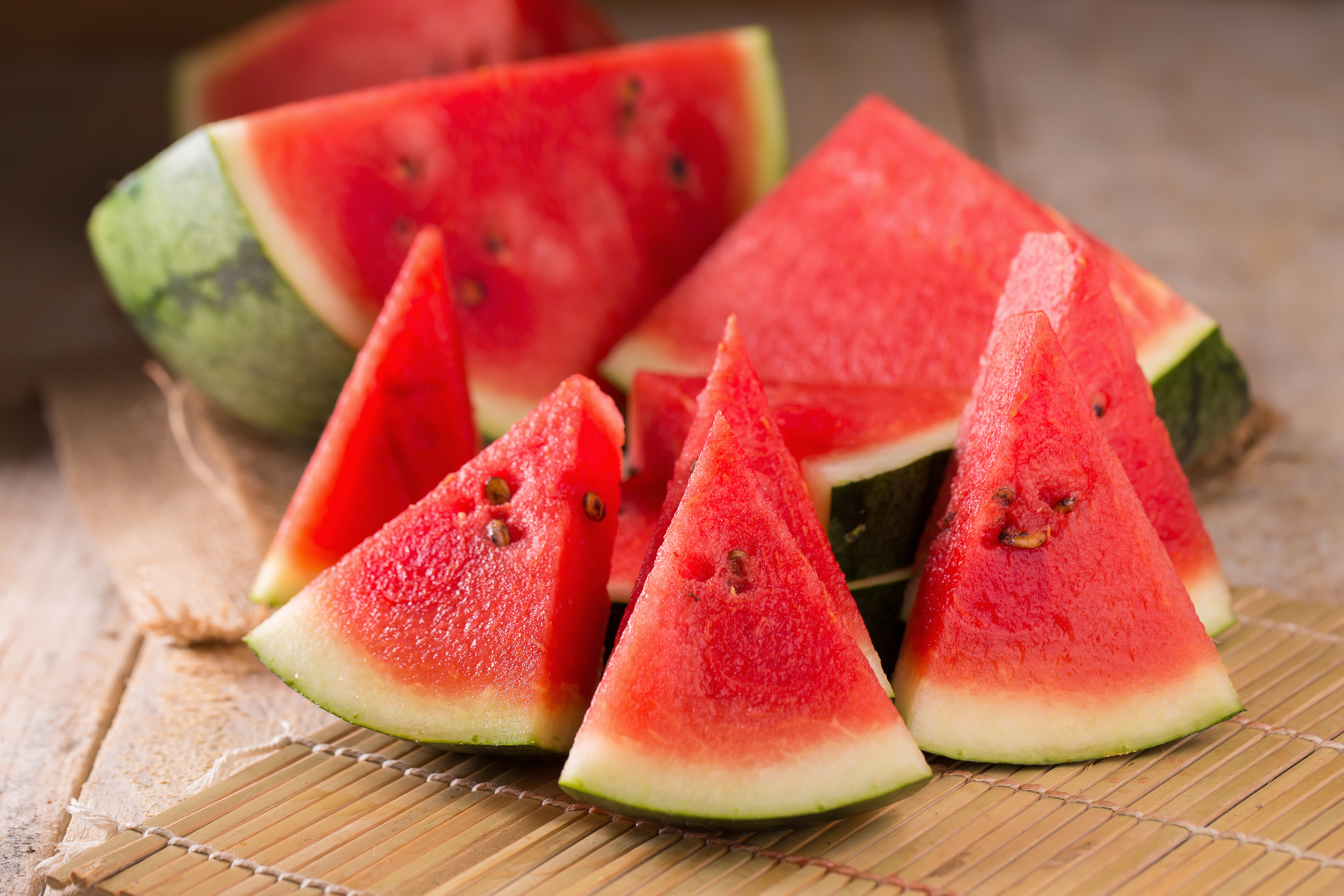 Watermelon,And,Watermelon,Pieces,In,A,Wooden,Background
