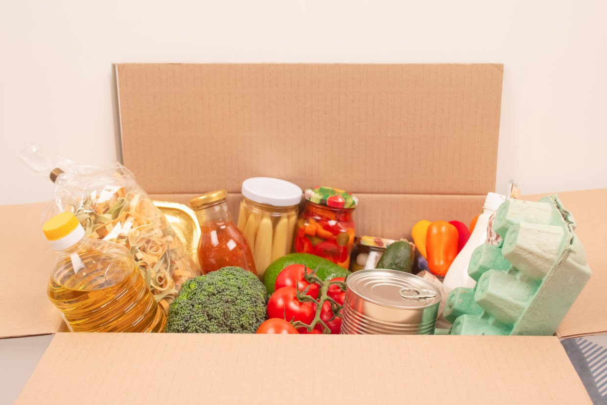 Donation,Box,With,Different,Groceries,,Food,Donations,On,Light,Background