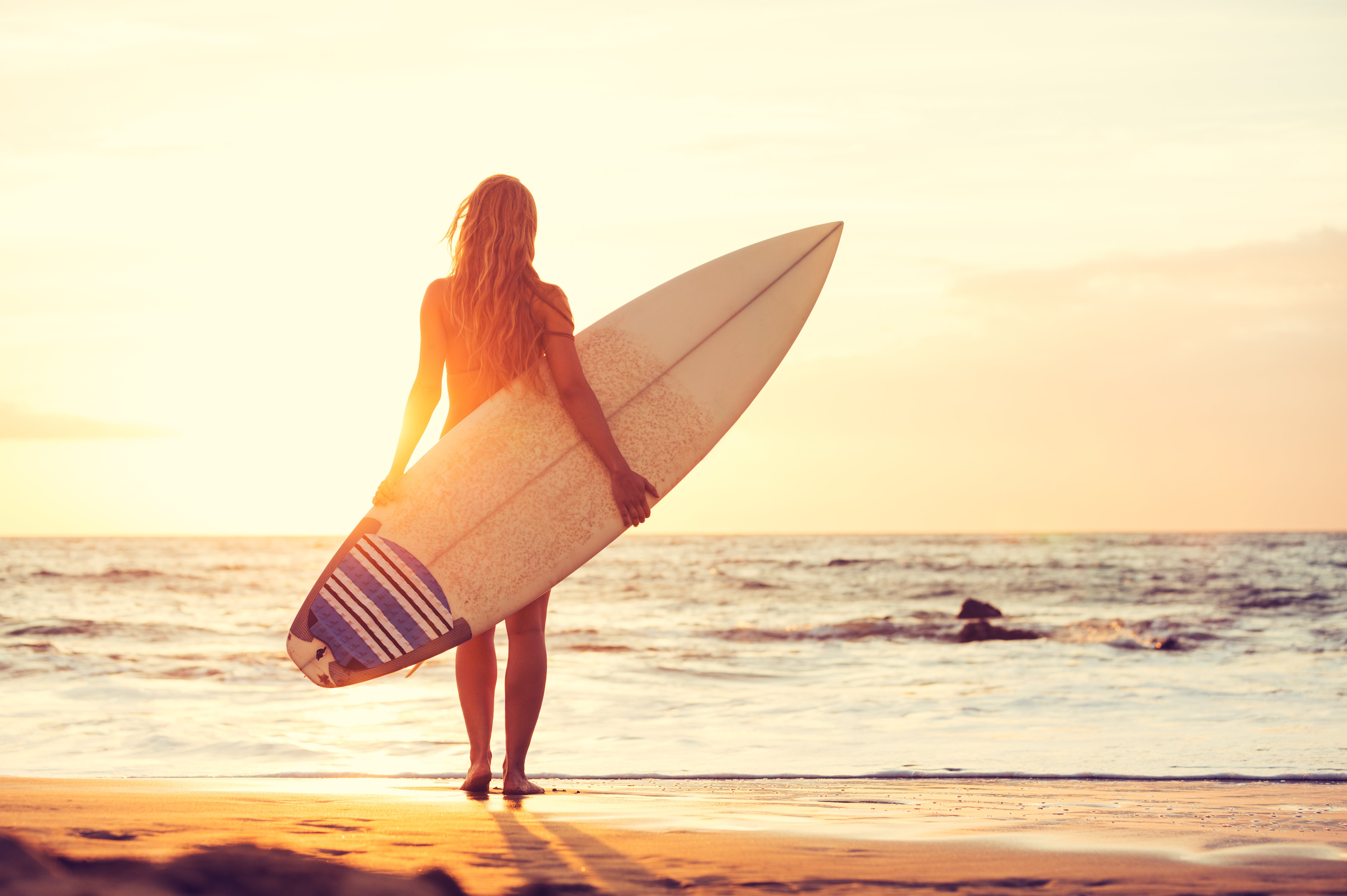Beautiful,Sexy,Surfer,Girl,On,The,Beach,At,Sunset