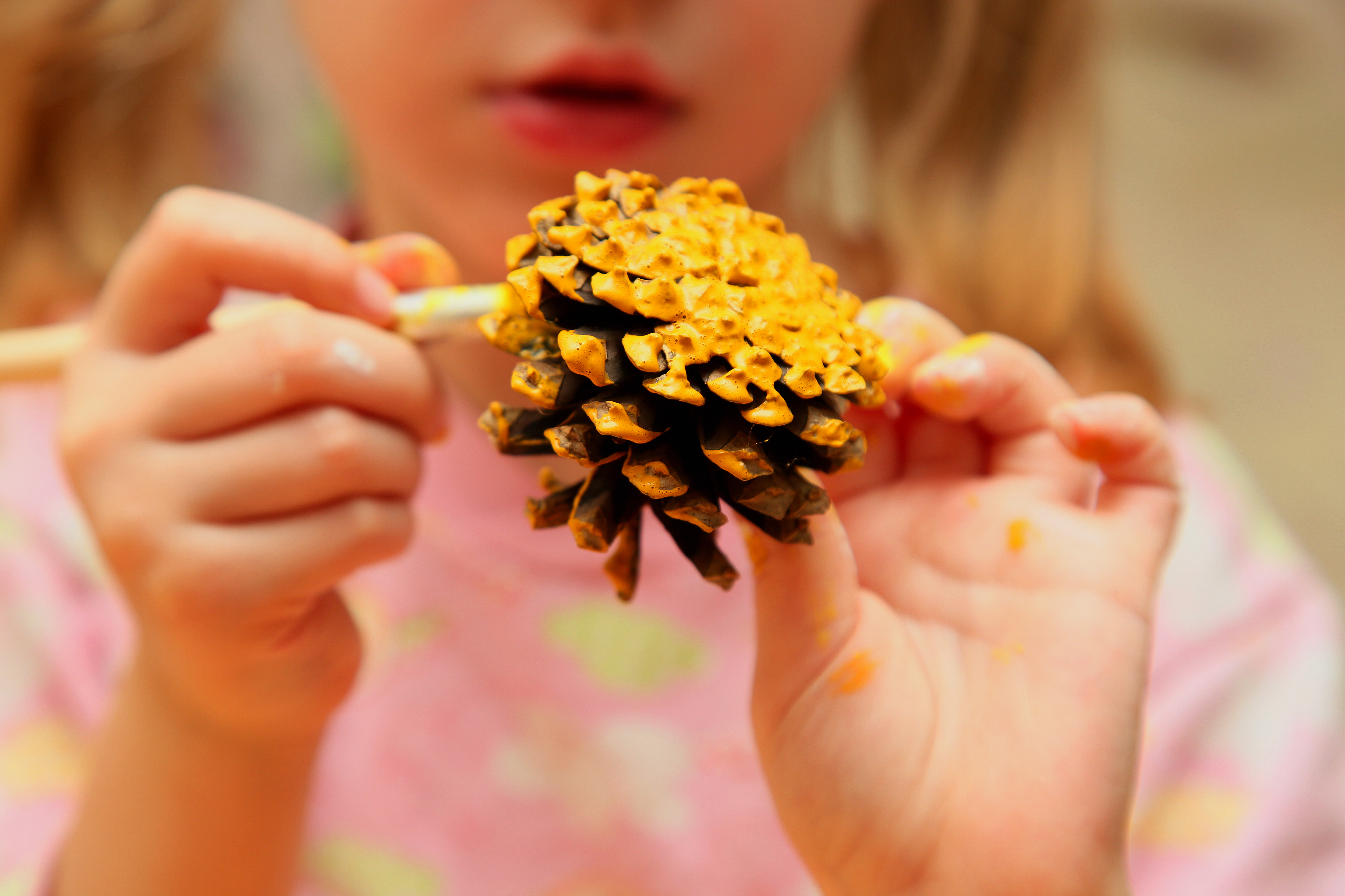 The,Child,Painting,Pinecone,In,Yellow,Colour