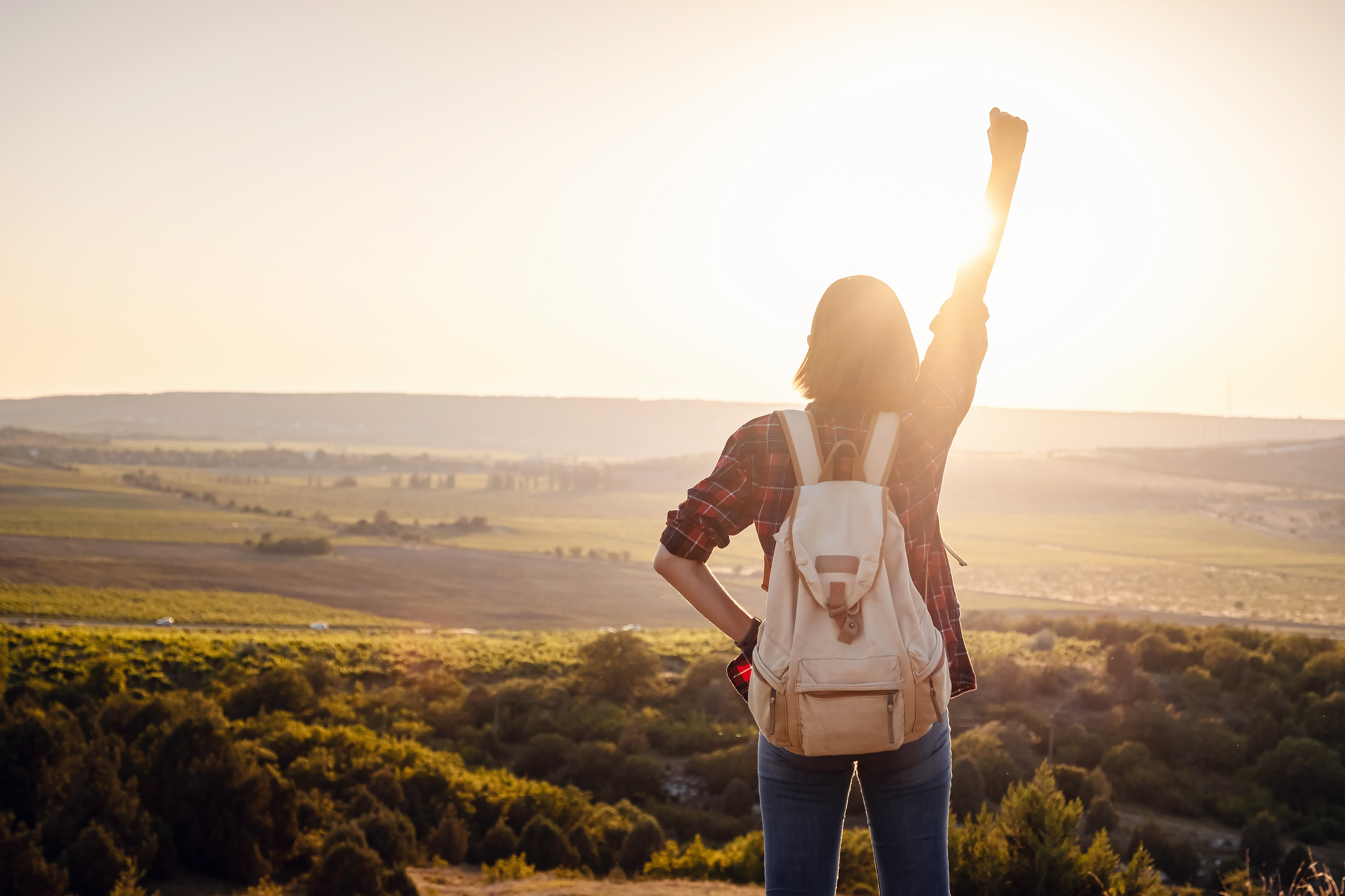 Happy,Woman,Stands,With,Raised,Hands,On,Background,Of,Sunset