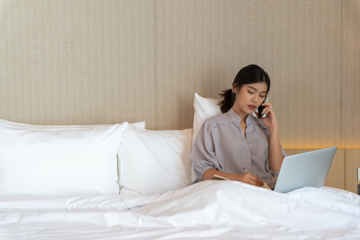 Young,Asian,Woman,Relaxing,In,The,Hotel,And,Working,With