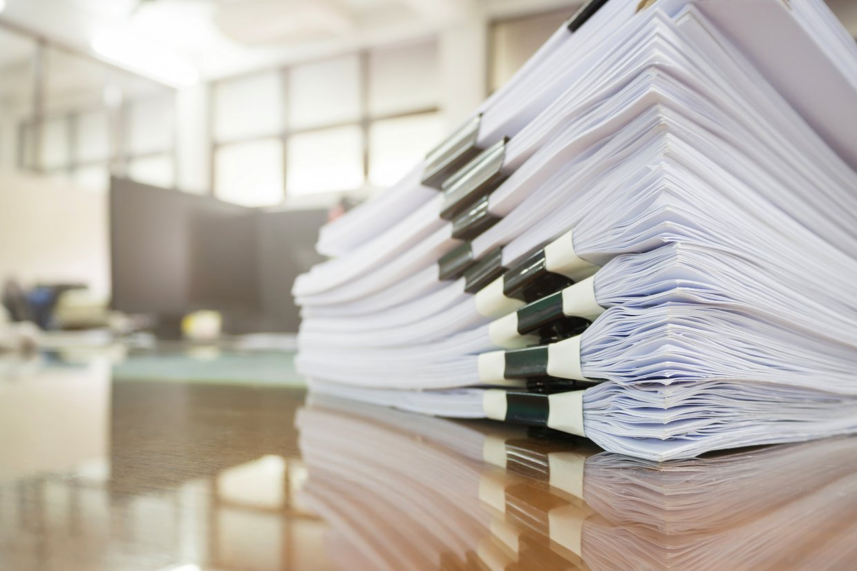 Pile,Of,Unfinished,Documents,On,Office,Desk,,Stack,Of,Business